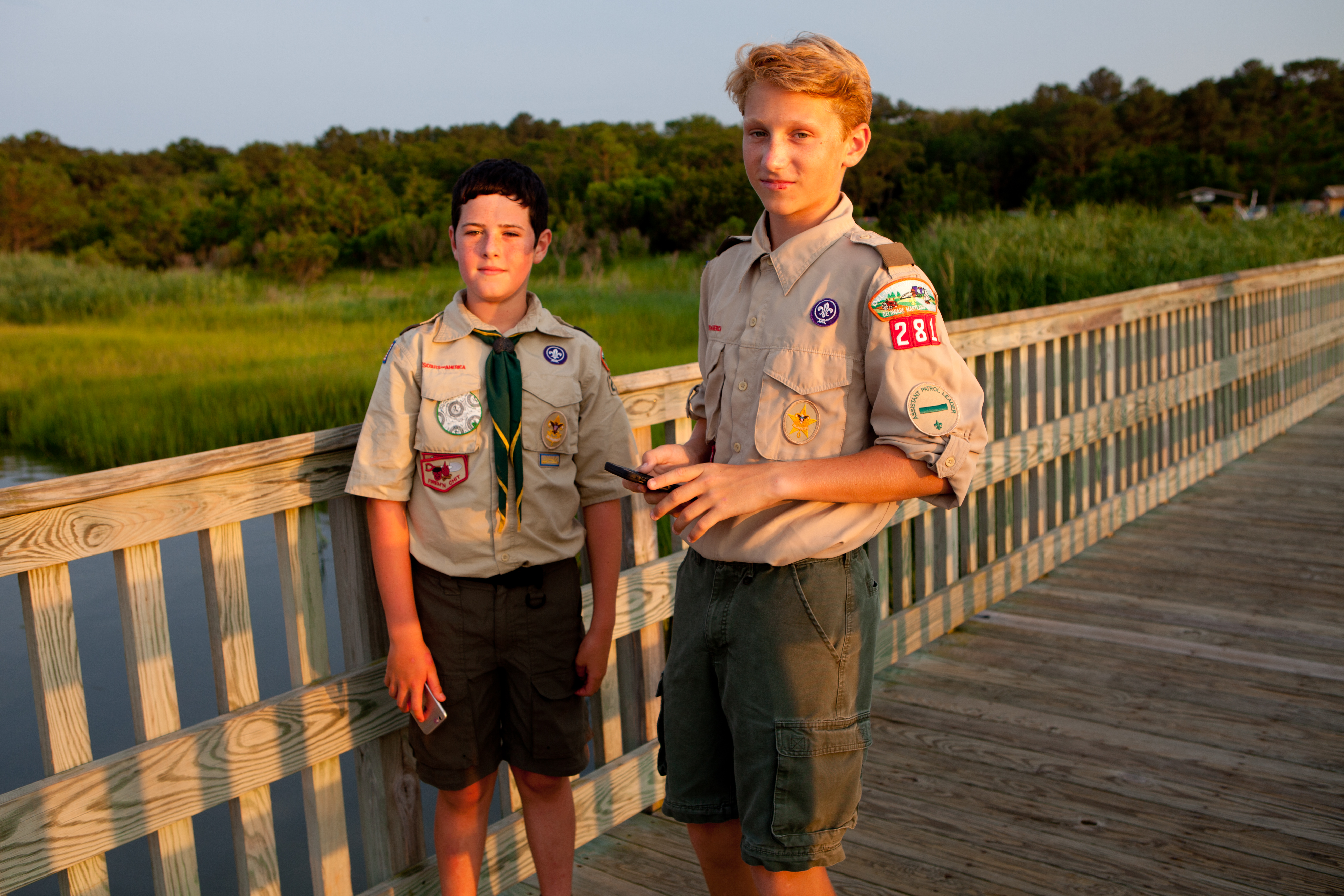 two boy scouts on a wooden bridge